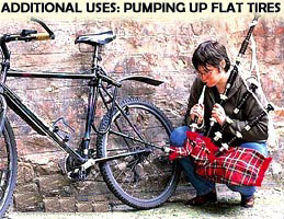 Cyclist pumping up flat  tire with bagpipes.